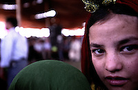 KABUL 25 August 2005..Young Afghan girl takes part to  the closing Olympics ceremony at Ghazi Stadium...On 23-25 August 2005, Special Olympics Afghanistan held its first national Games at Olympic Stadium in Kabul. ..More than 300 athletes, including 80 female athletes, experienced a taste of happiness and achievement for the first time in their lives. They competed in athletics, bocce and football (soccer). Because of cultural restrictions, males and females competed at separate venues...