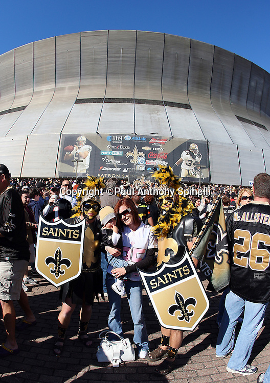 NEW ORLEANS - DECEMBER 07: New Orleans Saints fans pose for a  photo outside the stadium before the game against the Atlanta Falcons at the Louisiana Superdome on December 7, 2008 in New Orleans, Louisiana. The Saints defeated the Falcons 29-25. ©Paul Anthony Spinelli