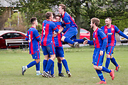 Graham Dingwall is mobbed by team mates after giving  ten man Athletic Monifieth the lead against Craigie in the Dundee Saturday Morning Football League at Fairmuir