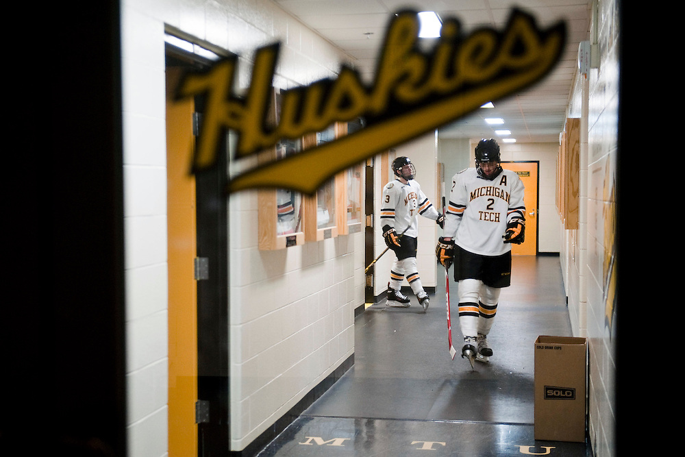HOUGHTON, MI -DEC. 12, 2014: Michigan Tech players Cliff Watson, right, and Matt Roy, left, walk back to the locker room after losing 3-1 to Minnesota Duluth Friday, Dec. 12, 2014 at MacInnes Student Ice Arena in Houghton, MI. Lauren Justice for The New York Times