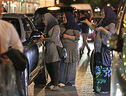 **MINIMUM FEE FOR USE - see  special instructions** © licensed to London News Pictures. London, UK. A group of women beggars approach a luxury car. Organised groups of beggars use woman and young children to beg around shopping areas of west London. The groups use minors to approach men and woman leaving high end shops, asking for money . The children are well trained, targeting only wealthy looking people with middle eastern appearance. The women supervise the children from a few steps away. Photo credit: J.A/LNP