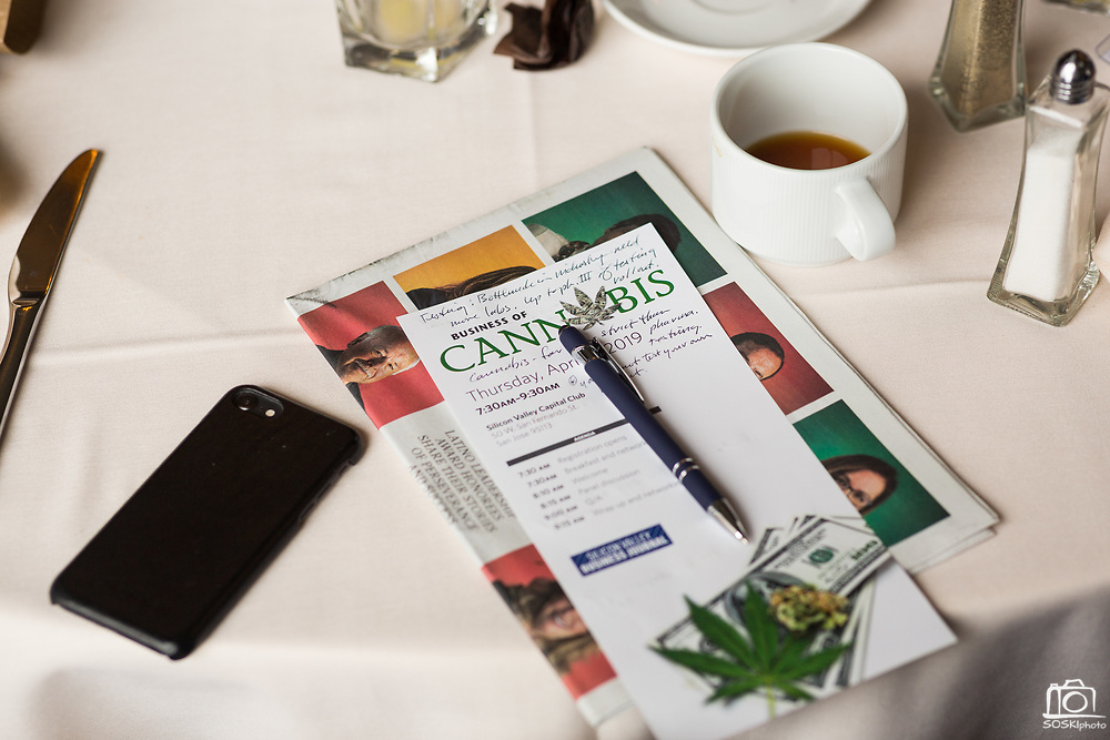 Attendees take notes during the Business of Cannabis event at the Silicon Valley Capital Club in San Jose, California, on April 4, 2019. (Stan Olszewski for Silicon Valley Business Journal)