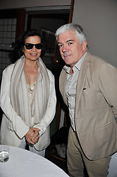 BIANCA JAGGER and TIM BLANKS at a dinner hosted by Bella Freud for German artist Marcel Odenbach at her home 275 Kensal Road, London W10 on 6th June 2011.