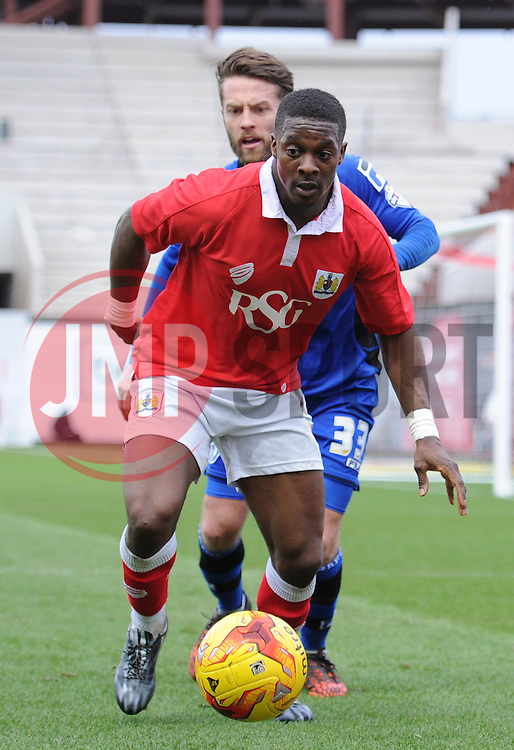 Bristol City's Kieran Agard controls the ball under pressure from Rochdale's Thomas Kennedy - Photo mandatory by-line: Dougie Allward/JMP - Mobile: 07966 386802 - 28/02/2015 - SPORT - football - Bristol - Ashton Gate - Bristol City v Rochdale AFC - Sky Bet League One