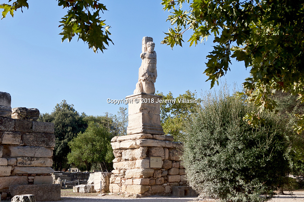 Statue of Triton at the Atrium of the Giants of the Odeion of Agrippa, a Roman addition to the Ancient Agora of Athens in Greece.<br />
