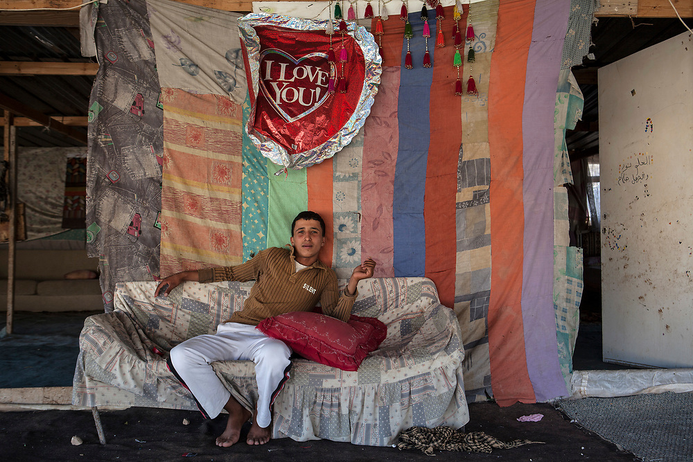A young Bedouin man from Khan Ahmar relaxes in his home. A graduate of the only school present in the area for the Bedouin, his future plans include working illegally as a builder for various Israeli construction projects.