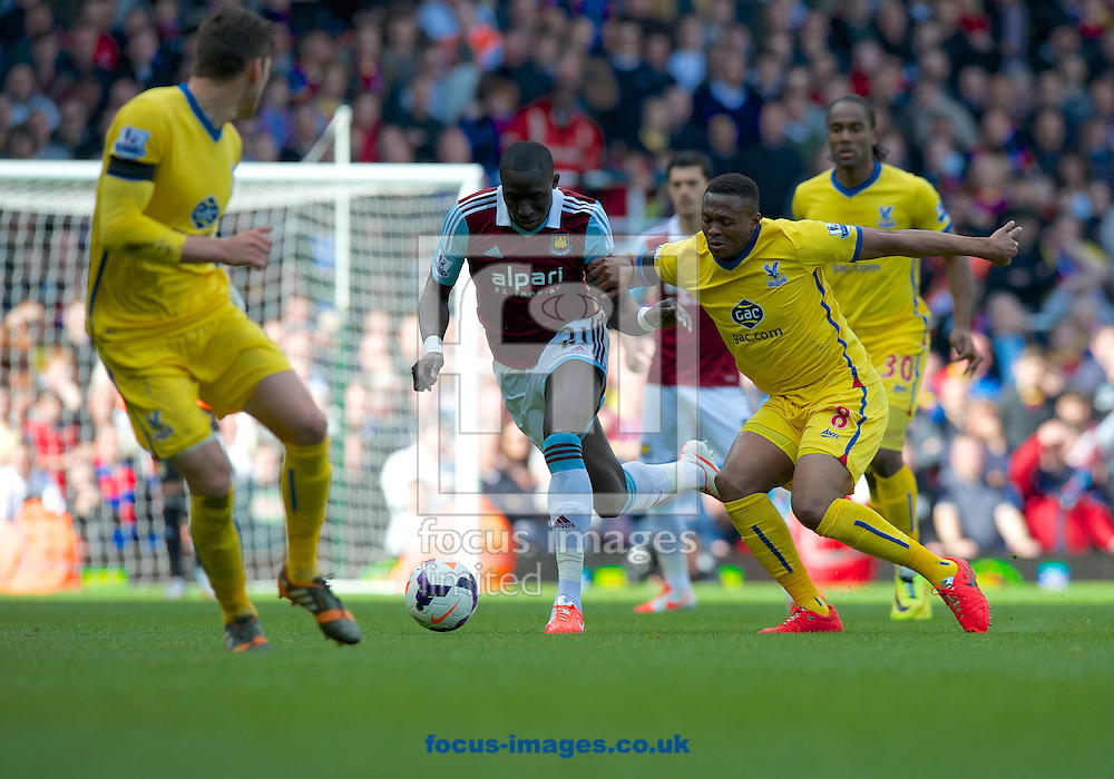Mohamed Diame of West Ham United is challenged by Kagisho Dikgacoi of Crystal Palace during the Barclays Premier League match at the Boleyn Ground, London<br /> Picture by Alan Stanford/Focus Images Ltd +44 7915 056117<br /> 19/04/2014