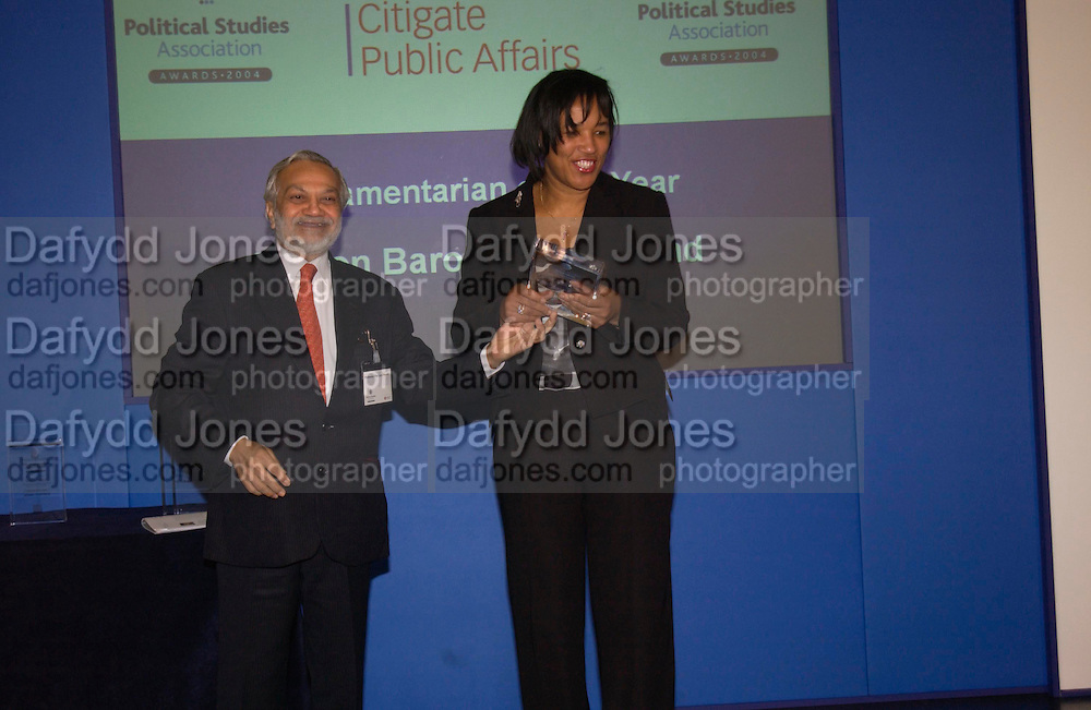 Professor Lord Parekh and Baroness Scotland. Political Studies Association Awards 2004. Institute of Directors, Pall Mall. London SW1. 30 November 2004.  ONE TIME USE ONLY - DO NOT ARCHIVE  © Copyright Photograph by Dafydd Jones 66 Stockwell Park Rd. London SW9 0DA Tel 020 7733 0108 www.dafjones.com