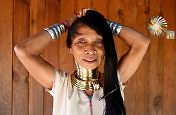 A Padaung woman with brass rings around her neck combs her hair at her home in Panpet Village, Demoso Township, Kayah State, Myanmar, April 11, 2016. The brass rings are first applied when the Padaung girls are about eight years old and as the girl grows older, longer coils are added up to 24 or 25 rings. EXPA Pictures © 2016, PhotoCredit: EXPA/ Photoshot/ U Aung<br /> <br /> *****ATTENTION - for AUT, SLO, CRO, SRB, BIH, MAZ, SUI only*****