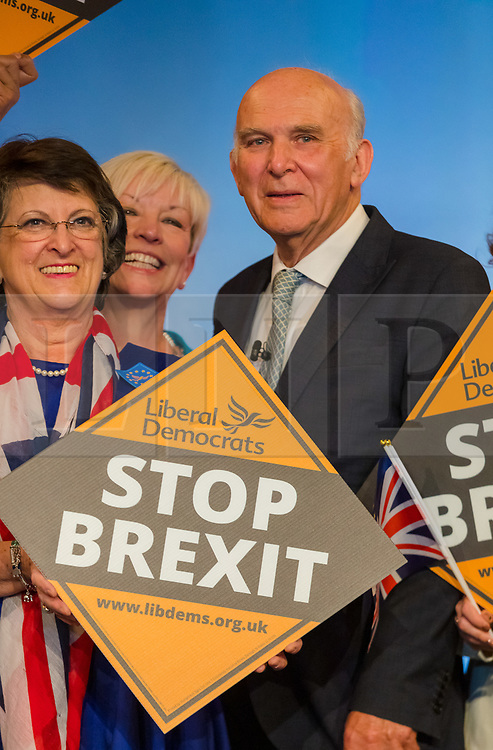 © Licensed to London News Pictures. 26/04/2019. London, UK. Liberal Democrat Leader Vince Cable poses for a group photograph with MEP candidates at the Liberal Democrat party European elections campaign launch held in Tobacco Dock. Liberal Democrat party leader, Vince Cable announced Member of European Parliament (MEP) candidates for the upcoming European Parliament elections that will take place from 23rd to 26th May 2019. Photo credit: Vickie Flores/LNP.