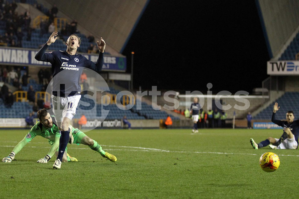 Martyn Woolford of Millwall after missing a chance during the Sky Bet Championship match between Millwall and Bolton Wanderers at The Den, London, England on 19 December 2014. Photo by Edmund  Boyden.