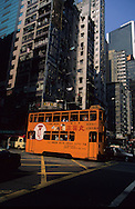 Hong Kong. tramways in western district        / Tramway aux pieds des buildings western district;   Sheung wan      / R00092/19    L940323c  /  P0001851