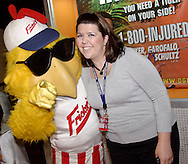 Frickers Frickin' Chicken stops for a photo with Hara's Brooke Folkerth before the Dayton Gems take on the Flint Generals at Hara Arena, Sunday, November 22, 2009.
