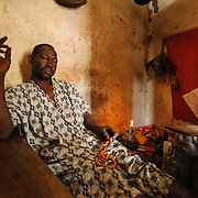 Kanye witch doctor, Alusine Kamara, believes mental health problems have a spiritual cause. He claims to have the power to communicate with demons and says he negotiates with them or  battles them with the aid of demon allies to address cases of demonic possession or other forms of spiritual warfare. He says he uses the device in the middle of the cloth on the wall to see the demons.
