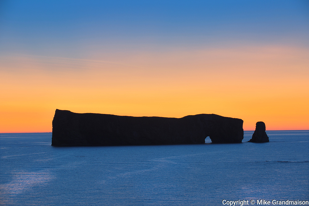 Roche Percé  on the Atlantic Ocean at dawn<br /> Percé <br /> Quebec<br /> Canada