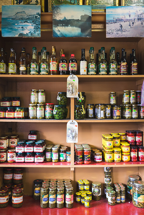 Shelves lined with the usual fare of  Central Grocery in the French Quarter.