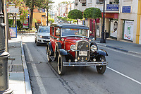 Circa 1930's Ford 8 saloon car driving through town centre, San Pedro de Alcantara, Malaga Province, Spain, 15th April 2018. Similar to car in Bonnie and Clyde movie. 201804154326.  If you can provide more information about this car please email me. Si tienes más información de este coche haga el favor de enviarme email. Gracias.<br /> <br /> Copyright Image from Victor Patterson, 54 Dorchester Park, Belfast, UK, BT9 6RJ<br /> <br /> t1: +44 28 9066 1296 (from Rep of Ireland 048 9066 1296)<br /> t2: +44 28 9002 2446 (from Rep of Ireland 048 9002 2446)<br /> m: +44 7802 353836<br /> <br /> e1: victorpatterson@me.com<br /> e2: victorpattersonbelfast@gmail.com<br /> <br /> The use of any of my copyright images is subject to my Terms & Conditions. It is IMPORTANT that you familiarise yourself with them. They are available at my website, victorpatterson.com.<br /> <br /> None of my copyright images may be used on the Internet unless they are visibly watermarked, i.e. © Victor Patterson within the body of the image. My metadata, denoting my copyright must NOT be deleted. <br /> <br /> Web use is extra at currently recommended NUJ rates. Maximum permitted web size is<br />  400kb. <br /> <br /> Images must not be passed on to a third party - they are for the use of the authorised recipient only.