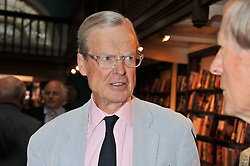 SIR TIMOTHY DAUNT at a party to celebrate the publication of Stanley Johnson's new book 'Where The Wild Things Were' held at Daunt Books, 83 Marylebone High Street, <br /> London W1 on 18th July 2012.