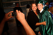 A brand new CJ alumnus stops for a photo before heading home following the Chaminade Julienne High School Class of 2012 commencement exercises at the Schuster Center in downtown Dayton, Monday, May 21, 2012.