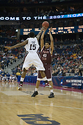 Southern Illinois Salukis guard Tony Young (15) tries to disrupt a pass by Virginia Tech Hokies forward A.D. Vasallo (40).  The #4 seed Southern Illinois Salukis defeated the #5 seed Virginia Tech Hokies 63-48 in the second round of the Men's NCAA Basketball Tournament at the Nationwide Arena in Columbus, OH on March 18, 2007.