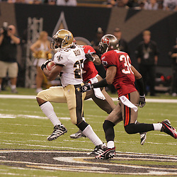 2008 September 7: New Orleans Saints running back Reggie Bush (25) runs past Tampa Bay Buccaneers defenders during the Saints home opener against the Tampa Bay Buccaneers at the Louisiana Superdome in New Orleans, LA.  The New Orleans Saints defeated the Tampa Bay Buccaneers 24-20.