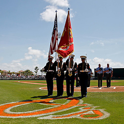 March 24, 2012; Sarasota, FL, USA; Members of United States Marine Corp stand with the flag for the national anthem before a spring training game between the Baltimore Orioles and the Washington Nationals at Ed Smith Stadium.  Mandatory Credit: Derick E. Hingle-US PRESSWIRE