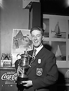23/04/1960<br /> 04/23/1960<br /> 23 April 1960<br /> Coca-Cola Canoe racing trophy presented. The Coca-Cola Perpetual trophy of Open Handicap Canoe Racing was presented to Mr Roger Greene of Sandymount, Co. Dublin at the conclusion of the 1st Irish Boat Week. Mr Greene, a member of the  Dun Laoghaire Canoe Club, in a canoe race on the river Liffey. Picture shows 22 year old Roger with his trophy.