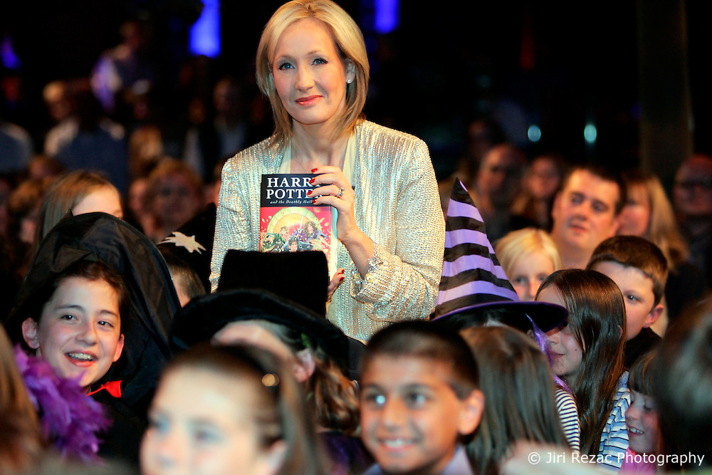 """UNITED KINGDOM ENGLAND LONDON 20JUL07 - Harry Potter author J.K. Rowling poses with her latest book amongst a crowd of children at the Natural History Museum, London. Her seventh and final book, """"Harry Potter and the Deathly Hallows"""" was launched tonight in an all-night reading and book-signing event with 1200 selected fans...jre/Photo by Jiri Rezac..© Jiri Rezac 2007..Contact: +44 (0) 7050 110 417.Mobile:  +44 (0) 7801 337 683.Office:  +44 (0) 20 8968 9635..Email:   jiri@jirirezac.com.Web:    www.jirirezac.com..© All images Jiri Rezac 2007 - All rights reserved."""