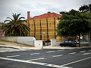 An old house under reconstrution at Avenida Gago Coutinho, next to the Lisbon Airport.This photograph is part of a body of work about Lisbon, feelings, affections and loneliness. Is about a city depressed by the crisis, but even so, tolerant and cosmopolitan.