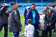Leeds United forward Tyler Roberts (11) and Leeds United midfielder Kalvin Phillips (23) greet a match day mascot during the EFL Sky Bet Championship match between Leeds United and Bristol City at Elland Road, Leeds, England on 15 February 2020.