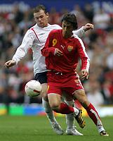 Photo: Paul Thomas.<br /> England v Macedonia. UEFA European Championships 2008 Qualifying. 07/10/2006.<br /> <br /> Wayne Rooney (L) of England battles with Goran Maznov.