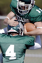 07 October 2006: Jordan Mussleman catches a happy Nick Panno in the end zone after Panno scores. The Titans of Illinois Wesleyan University started off strong with a touchdown on the 2nd play from scrimmage in the game.  The Titans led most of the way, but failed to maintain the lead in the 4th quarter giving up the decision of this CCIW conference game to the Red Men of Carthage by a score of 31 - 28. Action was at Wilder Field on the campus of Illinois Wesleyan University in Bloomington Illinois.<br />