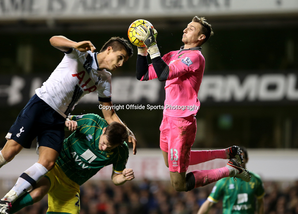 26 December 2015 - Premier League - Tottenham Hotspur v Norwich City<br /> Erik Lamela of Spurs and Ryan Bennett of Norwich try to head the ball, but Norwich goalkeeper Declan Rudd jumps and saves it<br /> Photo: Charlotte Wilson / Offside