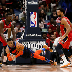 Feb 14, 2019; New Orleans, LA, USA; Oklahoma City Thunder guard Russell Westbrook (0) dives for a loose ball as New Orleans Pelicans center Julius Randle (30) and center Jahlil Okafor (8) defend during the fourth quarter at the Smoothie King Center. Mandatory Credit: Derick E. Hingle-USA TODAY Sports