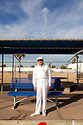 "Jerry Hobbs, 82, lawn bowls outside of the Bell Recreation Center in Sun City, Arizona December 8, 2010. The lawn bowling club is one of more than 120 clubs in the city of active retirees..Jerry's favorite part about lawn bowling is winning, he said...""This is why we worked 50 years,"" lawn bowler Norm Dickson said after bowling his ball. ""...in the cold,"" his teammate Myron Myers chimed in...2010 marks the 50th anniversary of Sun City, America's first retirement city that remains the largest today with more than 40,000 residents 55 and older."