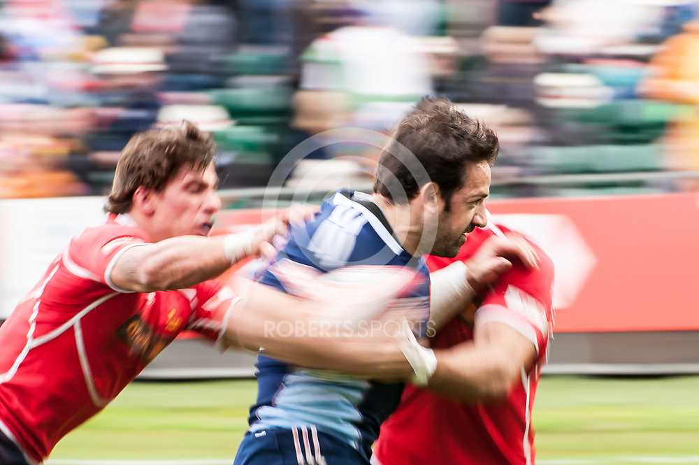 France's Julien Candelon drives through two Spain players to score a try. Action from the IRB Emirates Airline Glasgow 7s at Scotstoun in Glasgow. 4 May 2014. (c) Paul J Roberts / Sportpix.org.uk