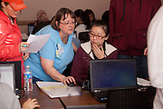 Accounting Instructor Susanne Freeland (Left) helps international student Xiuming Jin complete her tax forms at a volunteer income tax program offered by the College of Business at Ohio University.