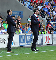 Cardiff City Manager, Malky Mackay and Everton Manager, Roberto Martinez watch on as both of there teams play.  - Photo mandatory by-line: Alex James/JMP - Tel: Mobile: 07966 386802 31/08/2013 - SPORT - FOOTBALL - Cardiff City Stadium - Cardiff - Cardiff City V Everton - Barclays Premier League