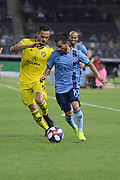 Artur of Columbus Crew SC tries to take the ball away from Maximiliano Moralez during a MLS soccer match, Wednesday, Aug. 21, 2019, in New York (Errol Anderson/Image of Sport)