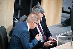"27.02.2020, Hofburg, Wien, AUT, Hofburg, Sitzung des Nationalrates mit Aktueller Stunde der Grünen zu Transit, Beharrungsbeschluss zu Obergrenzen für Bundeshaftungen, Erklärung Anschober und Nehammer zu Corona, im Bild v. l. Rudolf Anschober (Gruene), Karl Nehammer (OeVP)// during meeting of the National Council of austria due to the topic ""Meeting of the National Council with the current Greens hour on transit, decision to persevere on upper limits for federal liability, declaration of Anschober and Nehammer about Corona"" at Hofburg palace in Vienna, Austria on 2020/02/27, EXPA Pictures © 2020, PhotoCredit: EXPA/ Florian Schroetter"