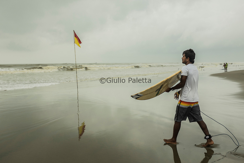 Rashed Alam, getting ready for surfing on Cox's Bazar's beach, Bangladesh