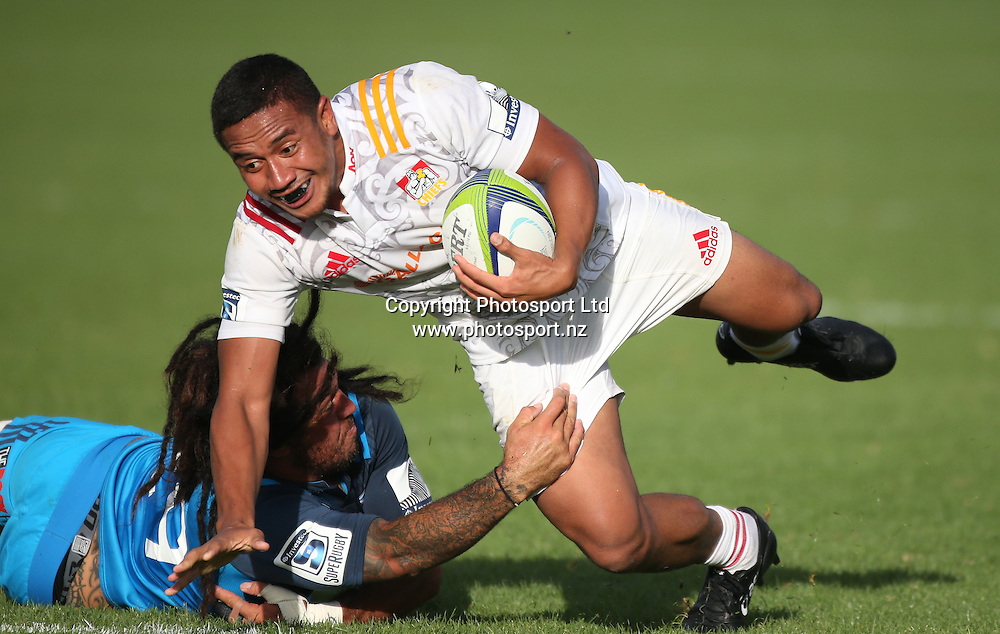 Chiefs player Lutero Laulala tries to break the tackle of Blues player Renee Ranger during the Blues vs Chiefs pre season Super Rugby match played at Alexandra Park in Auckland on the 17th February 2017. <br /> Credit; Peter Meecham/ www.photosport.nz