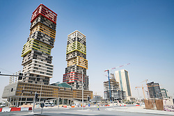 Twin Towers high-rise building under construction in Marina district in new Lusail City in Doha Qatar