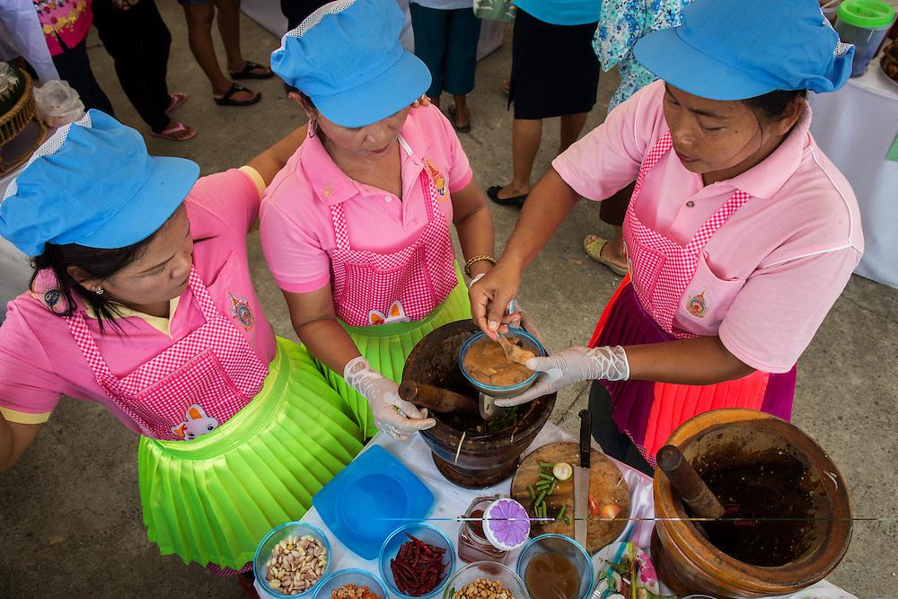 Contestants prepare a Thai sauce as Rural Thailand celebrates HM Queen Sirikit's birthday in Nakhon Nayok, Thailand.