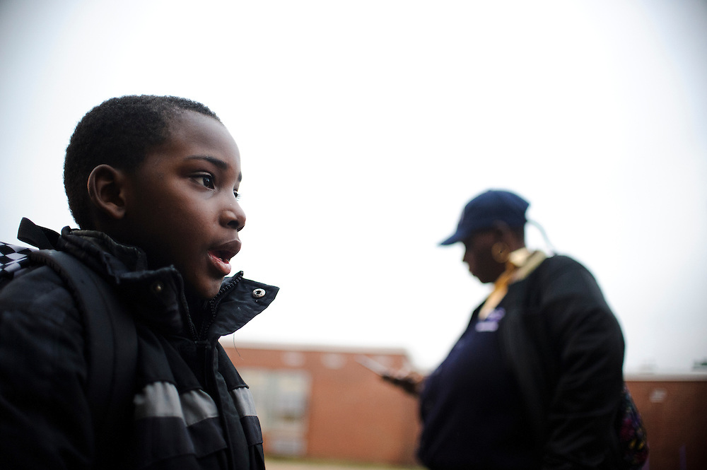 Photo copyright 2009, Matt Roth<br /> Wednesday, February 29, 2012<br /> <br /> City Springs Elementary School first grader Jahmal Harrison waits with his mother Tameka Harrison, both homeless, across the street from his school for the 11 bus to their shelter Wednesday, February 29, 2012.  Tameka, who can't work due to a facial injury, volunteers at her son's school where poverty is the norm. Ninety-six percent of the student body qualifies for free lunches. Tameka and Jahmal, who suffers from lead poisoning, used to live in one of the close-by housing projects, but have been homeless for the last two months. They're currently staying at Sarah's Hope Shelter in West Baltimore. Tameka thought she was going to be moving into an apartment Friday, under the auspices that both the security deposit and the first month's rent would be waived, but the latter was not. So, they're staying in the Sarah's Hope shelter a little while longer.