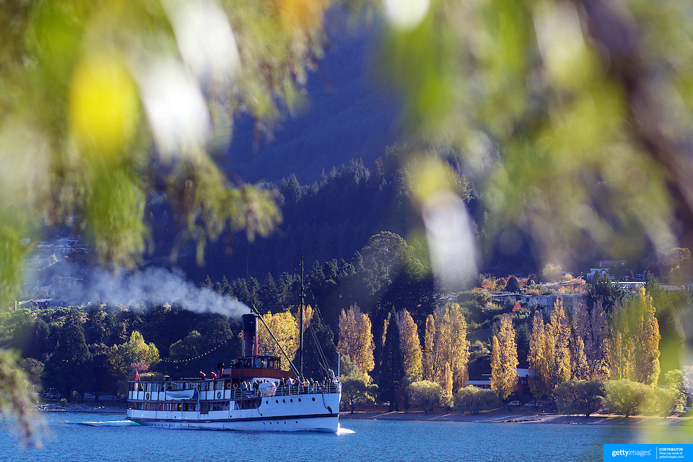 The TSS Earnslaw,  a 1912 Edwardian vintage twin screw steamer on the waters of Lake Wakatipu in, Queenstown, New Zealand. .It is one of the oldest tourist attractions in Central Otago, and the only remaining passenger-carrying coal-fired steamship in the southern hemisphere..The TSS Earnslaw heads along Lake Wakatipu from Queenstown  daily, running tourist trips to Walter Peak Station passing magnificent  peaks and contrasting shoreline foliage along the lakeside. Queenstown, New Zealand. 20th April 2011. Photo Tim Clayton
