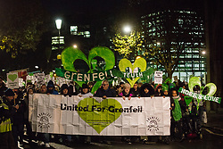 London, UK. 14 November, 2019. Members of the Grenfell community, joined by firefighters and wellwishers, take part in the 29th Grenfell Silent Walk around North Kensington on the monthly anniversary of the Grenfell Tower fire on 14th June 2017 during which 72 people died. It has been a difficult month for the Grenfell community following publication of the first phase of the Grenfell community and much criticised comments made by Leader of the House of Commons Jasob Rees-Mogg.