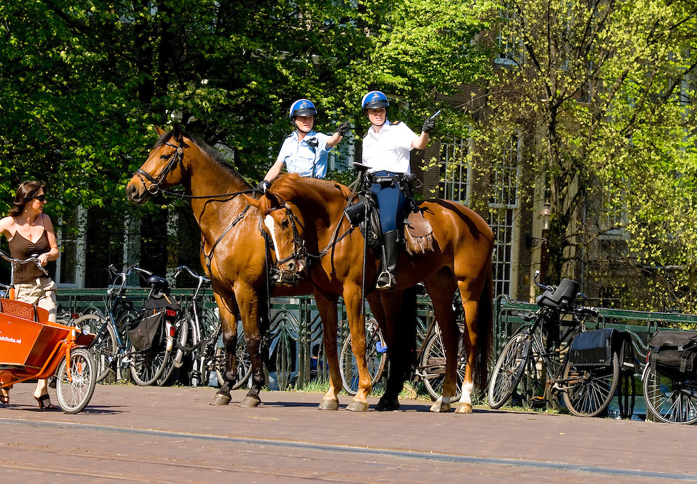 Mounted Dutch policewomen in the centre of Amsterdam, Holland