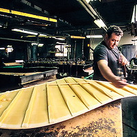 A technician working on the sound board at the Steinway factory, Astoria, Queens, New York.