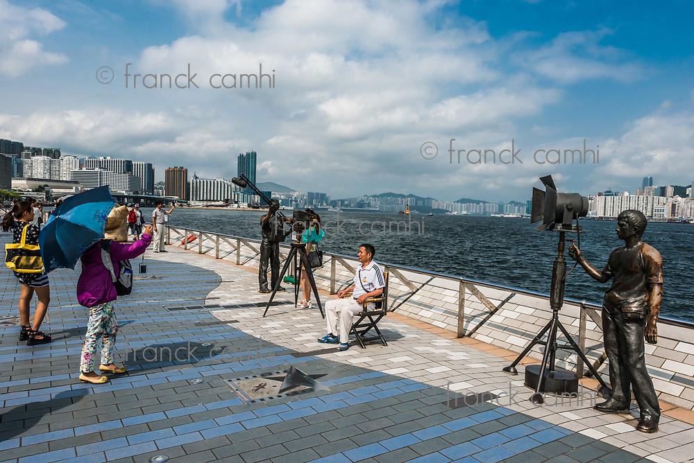 Kowloon, Hong Kong ,China - June 9, 2014: people tourist Avenue of Stars Tsim Sha Tsui